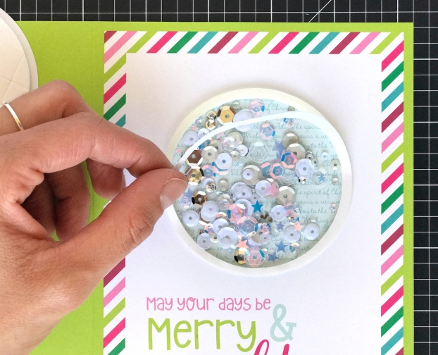 Holiday Sparkle Shaker Card #CTMH #CloseToMyHeart #CTMHHolidaySparkle #shakercard #shakerwindowcard #shakerwindow #cardwindow #cardmaking #holiday #Christmas #sentiments #CutAbove® #CutAbove #diy #warmwishes #holidaymagic #sequins #comfortandjoy #believe